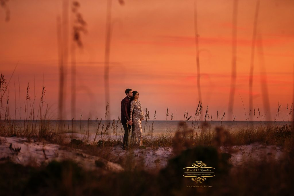 maternity picture at grayton beach at sunset in sequin dress in the dunes