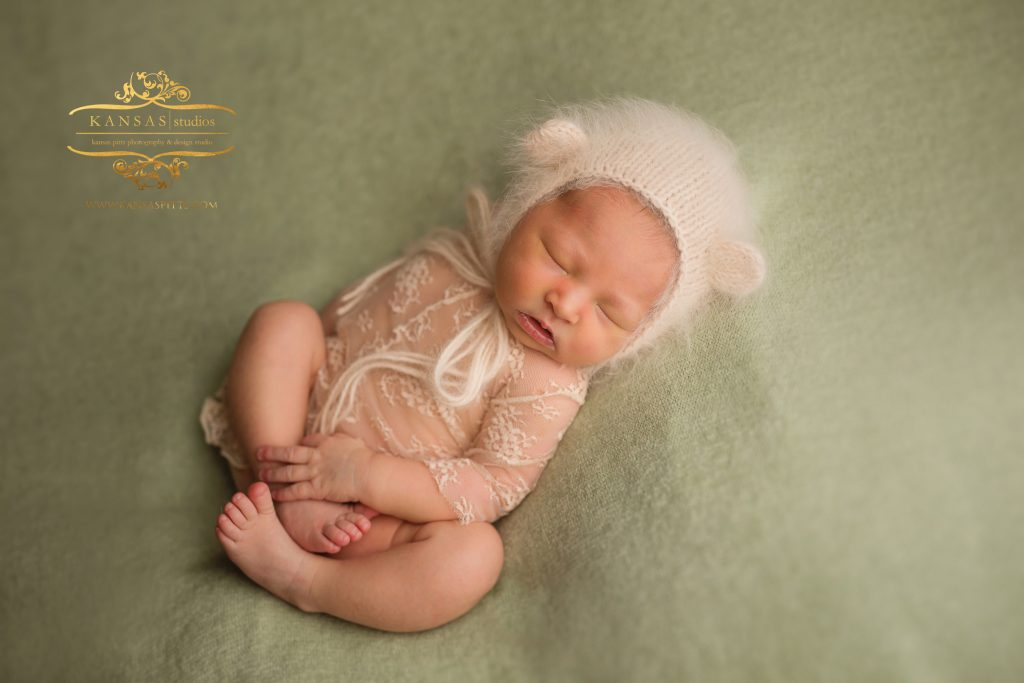 Sweet Baby girl in pink on mint green backdrop newborn in Santa Rosa Beach